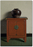 Chinese pot on red chest