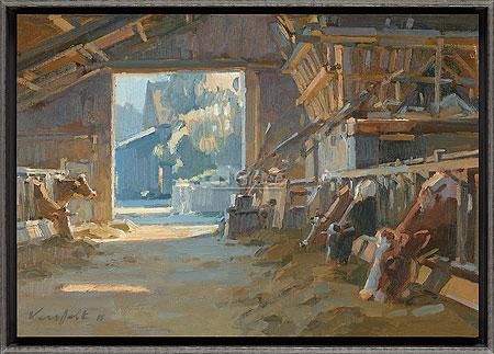 Koeien in stal met zonlicht