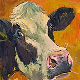 Zwartbonte koe tegen goud