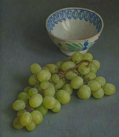 Tros druiven met oude kom