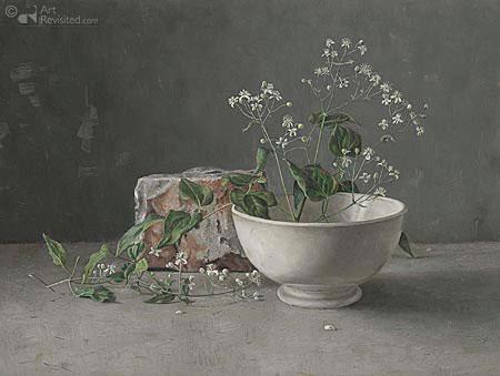 Witte schaal met bloesem en steen